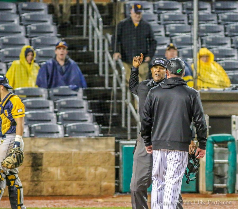 Head coach Jeff Waggoner is ejected from the game after arguing a batter's interference call in the ninth inning.