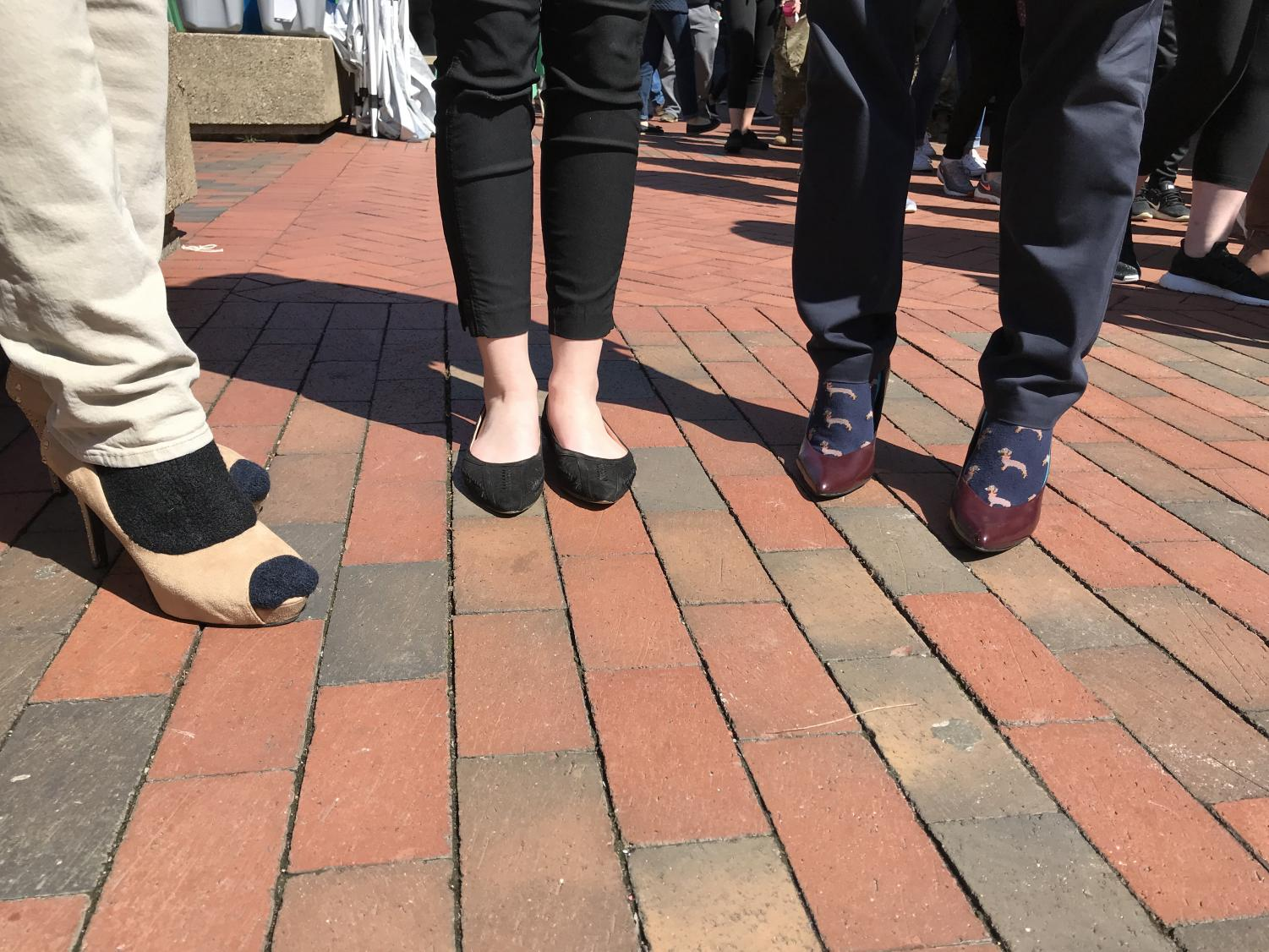 SGA President Matt Jarvis (Left), SGA Vice President-Elect Hannah Petracca (Middle) and Assistant Dean of Student Affairs Matt James show off their footwear for Walk a Mile in Her Shoes Thursday.