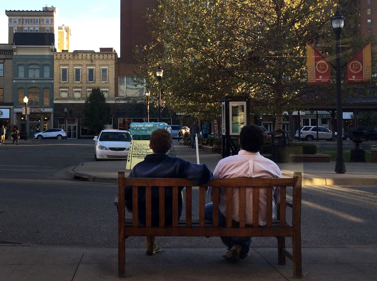 Franklin sits and relaxes in downtown Huntington with his friend and roommate Josh Hastings.