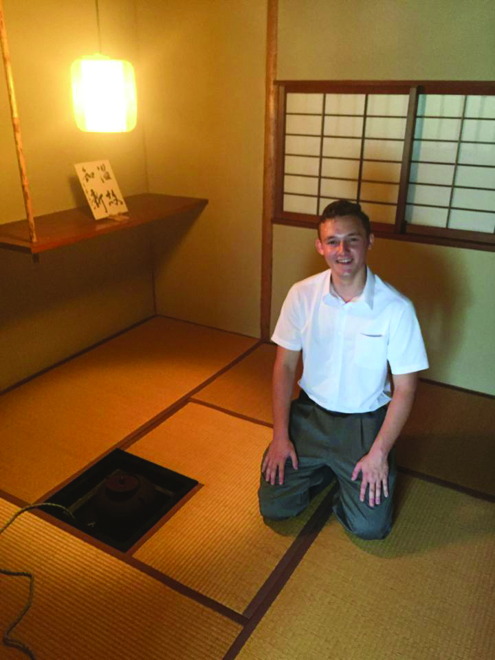 Christian Thompson in a Japanese Sado club tea house during his trip overseas in high school.