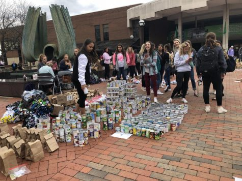 Greek Life collects canned foods, prepares hygiene kits for charities
