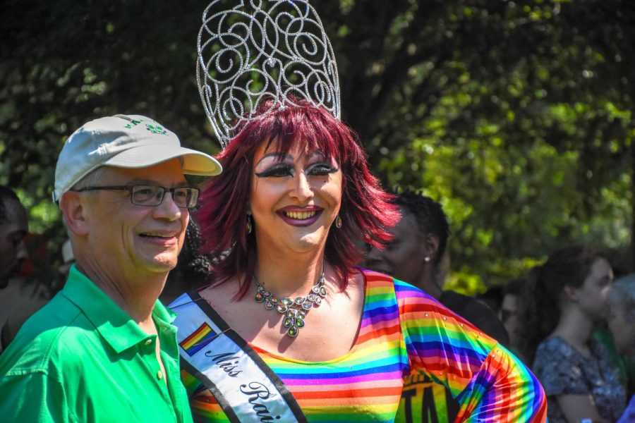 Marshall University President Jerry Gilbert poses with 2018 Miss Rainbow of West Virginia, Sadae Spears.