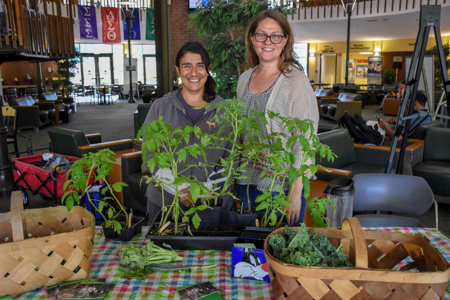 Angela Kargul and Amy Parsons-White at the Memorial Student Center holding their weekly farmer's market.