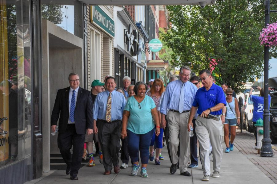 City leaders on July 17, 2018, guiding the community with their first steps on the journey of walking to the moon.
