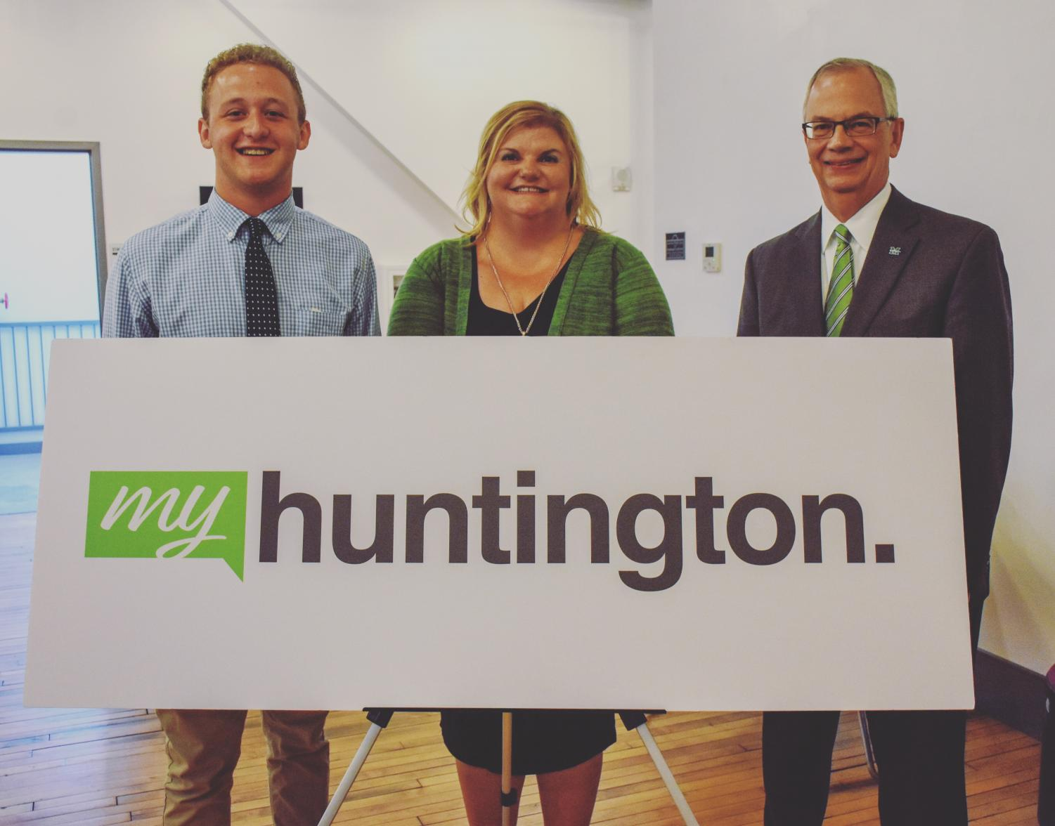 Franklin Norton, left, stands with Sarah Payne, associate vice president for external engagement at the Marshall University Research Corporation, and Marshall University president Jerry Gilbert at the My Huntington press conference on July 9.