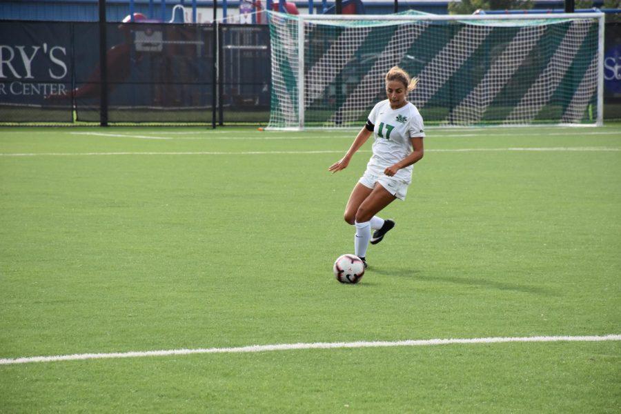 Senior+midfielder+Jenna+Zuzolo+dribbles+the+ball+as+she+moves+into+Duquesne+territory.