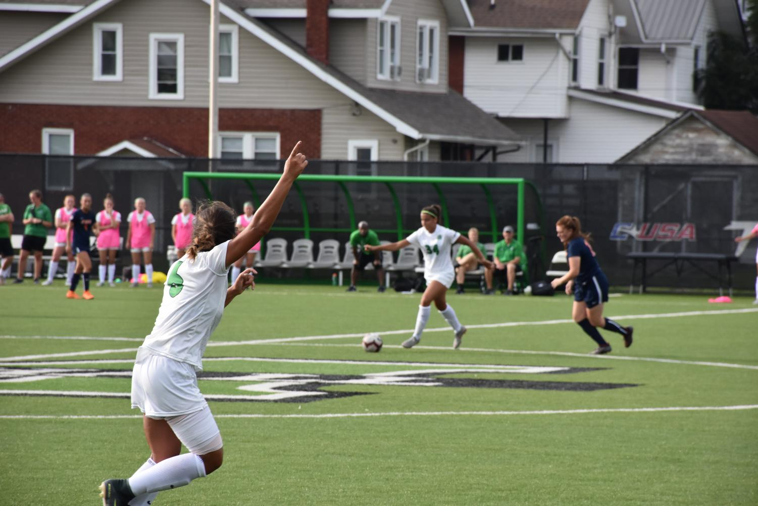 Junior forward Marah Abu-tayeh gestures for a pass from sophomore forward Canaan Booton in Marshall's home-opener against UT-Martin.  Abu-tayeh's is currently tied with her sister, Farah Abu-tayeh, for a team-leading 5 goals.
