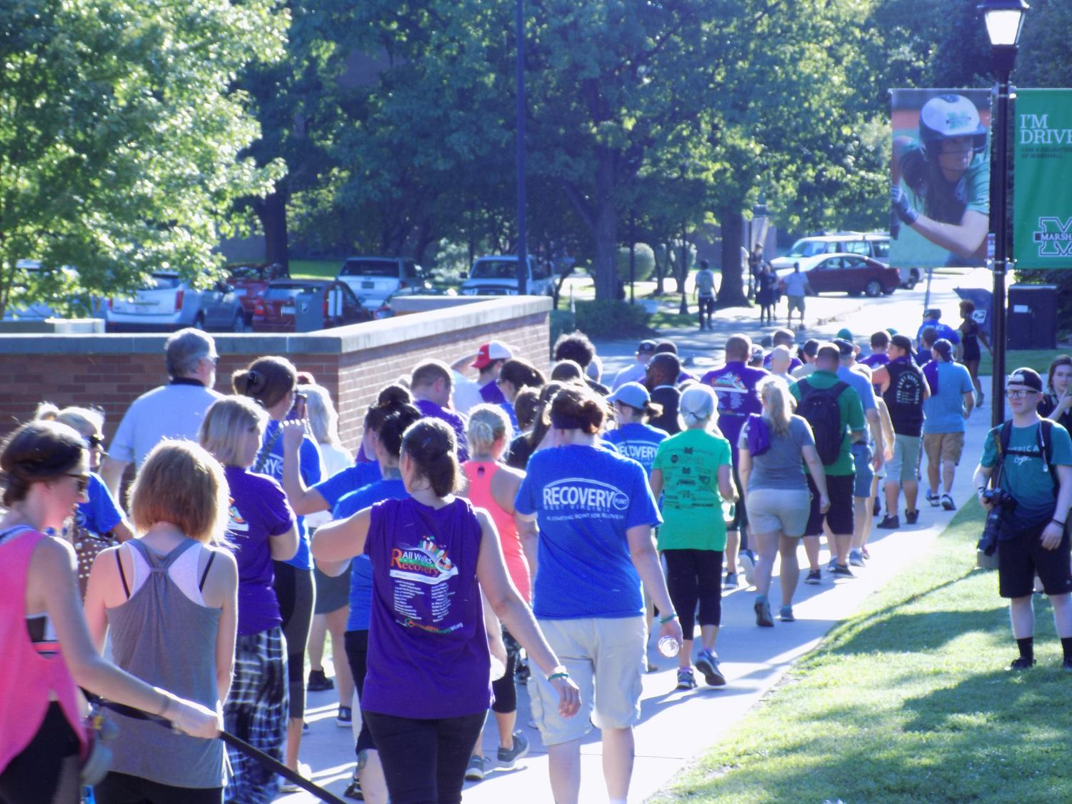 Community members walk during the Walk for Recovery event on Tuesday, September 4, 2018.