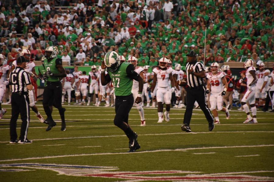 Quarterback Isaiah Green (17) runs off the field after NC State forced the Herd to punt. Green  is suppressed by NC State's heavy coverage of Tyre Brady.