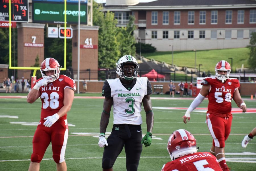 Redshirt+sophomore+running+back+Tyler+King+shows+emotion+in+the+first+quarter+of+Marshall%E2%80%99s+35-28+win+over+the+Miami+%28Ohio%29+RedHawks.+King+accumulates+67+rushing+yards%2C+32+receiving+yards+and+83+combined+returning+yards+in+the+game.