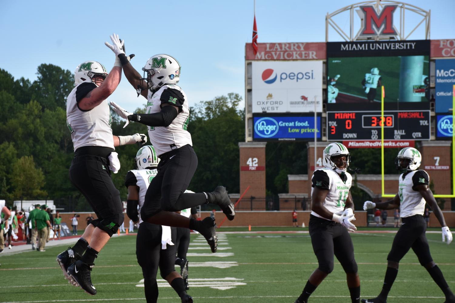Redshirt junior offensive lineman Levi Brown and redshirt senior running back Keion Davis celebrate with high fives after the Herd takes a 14-0 lead over Miami in the first quarter. Davis and redshirt senior Anthony Anderson, combined to score three of Marshall's five total touchdowns against the RedHawks.