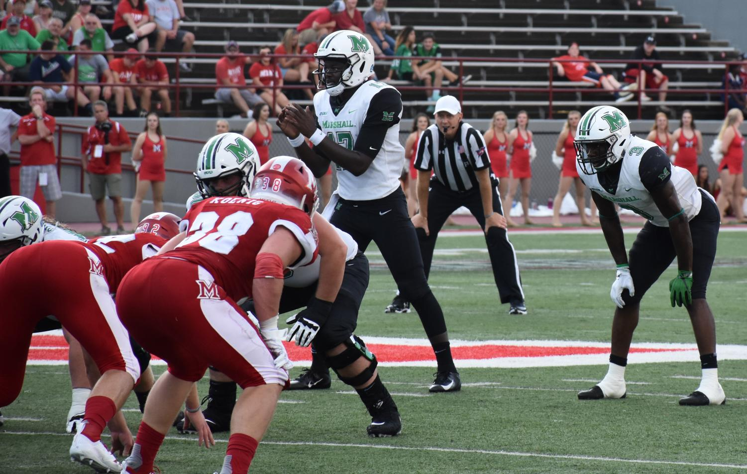 Redshirt freshman quarterback Isaiah Green (white jersey, left) prepares to take a snap under-center for the Herd next to redshirt sophomore running back Tyler King (white jersey, right). Green's youth is aided by an experienced backfield and receiving corps.