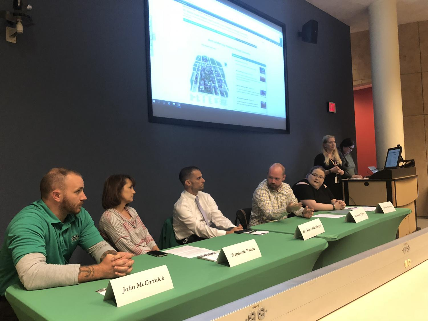Suggested photo caption: John McCormick, Stephanie Ballou, Dr. Marc Hettlinger, Dr. Aaron Upton and Kristin Cookson participate in a panel discussion on mental health with Marshall students in Drinko Library Room 402.