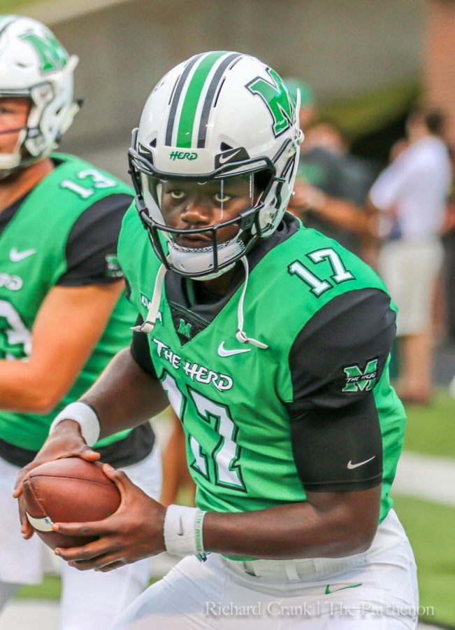 Redshirt+freshman+quarterback+Isaiah+Green+warms+up+before+Marshall%27s+home+opener.+Green+is+the+youngest+Marshall+starting+quarterback+since+Rakeem+Cato+in+2014.