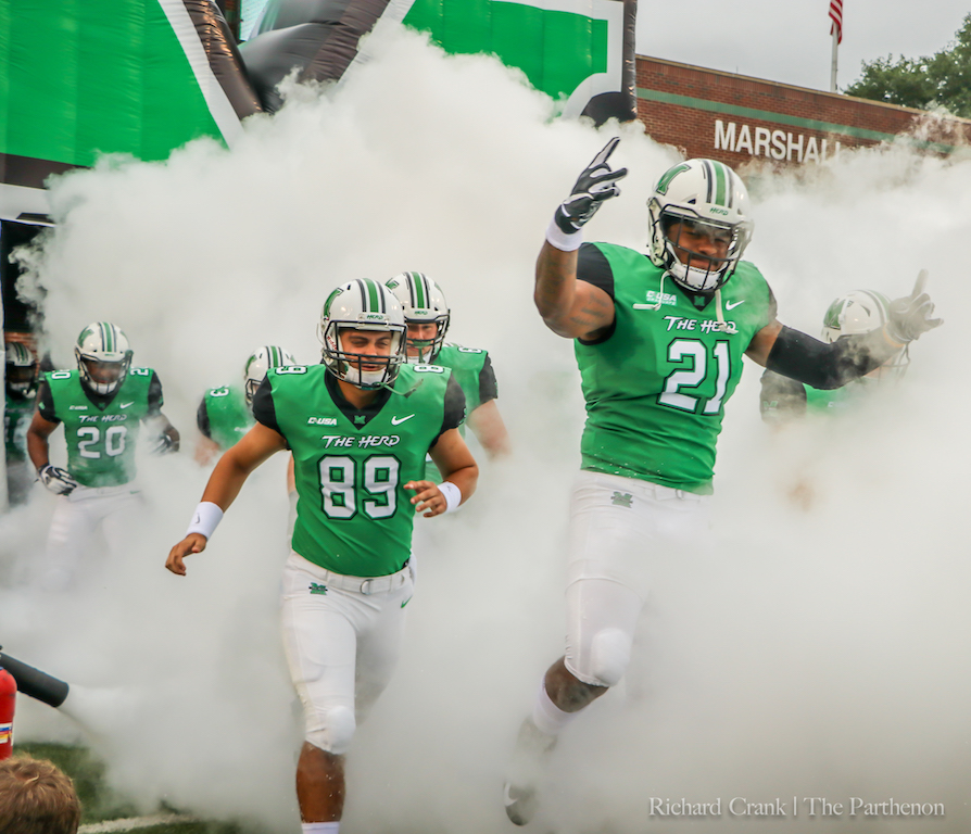 Redshirt+senior+running+back+Anthony+Anderson+%28right%29+and+junior+long+snapper+Matt+Beardall+%28left%29+lead+the+Herd+out+of+the+tunnel+before+Marshall%27s+2018+home+opener.+