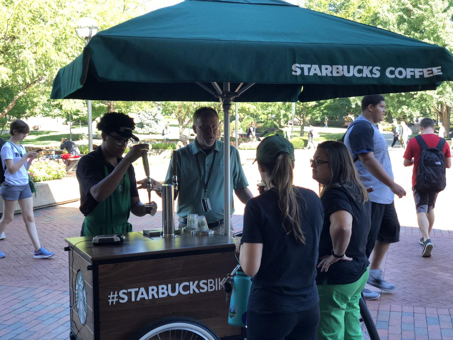 Starbucks employees serve samples of nitro cold brew coffee on the Memorial Student Center Plaza Sept. 14.