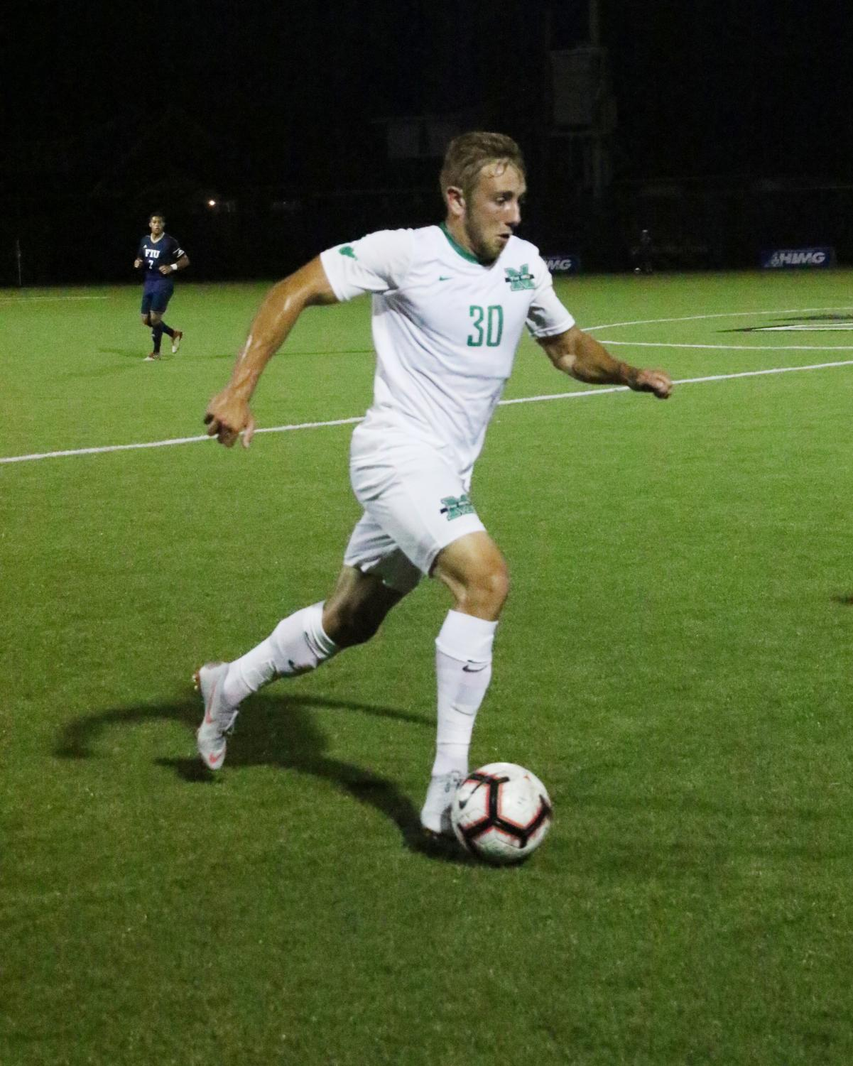 Freshman defender Jan-Erik Leinhos handles the ball across midfield in a Marshall home match in 2018.