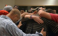 Huntington community stands together in worship, praise to help people on the road to recovery