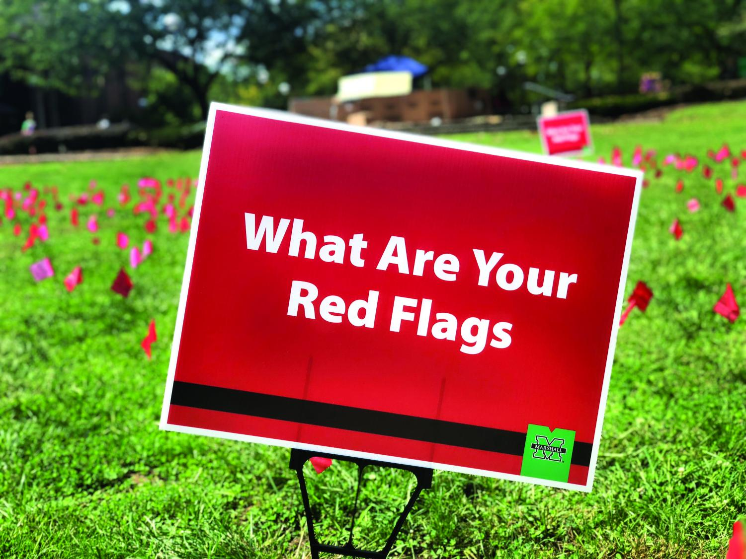 Red flags are set up on campus to represent the warning sign of violence in relationships.