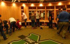 High school students renovate men's basketball locker room