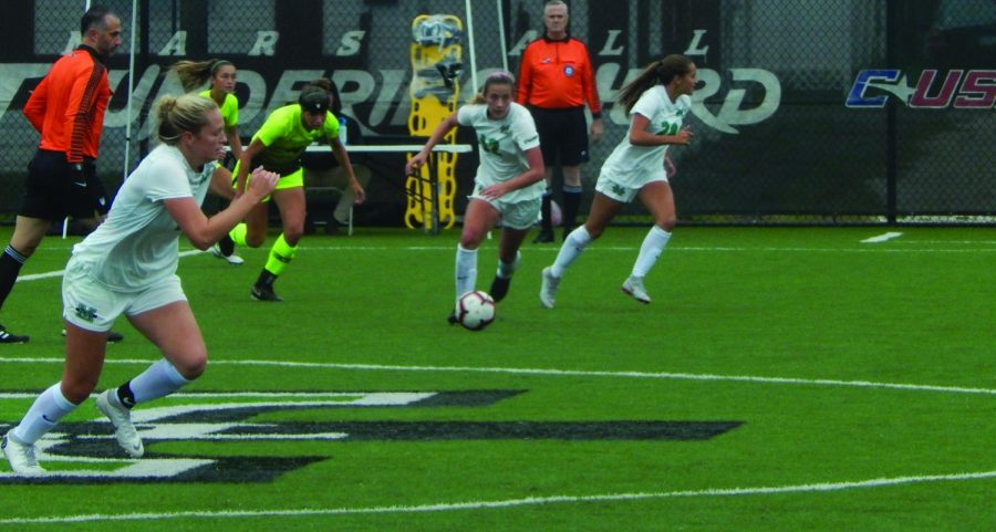 Junior midfielder Gabby Powers advances the ball across the midfield against North Texas. Powers has started all 15 matches for the Herd this season.