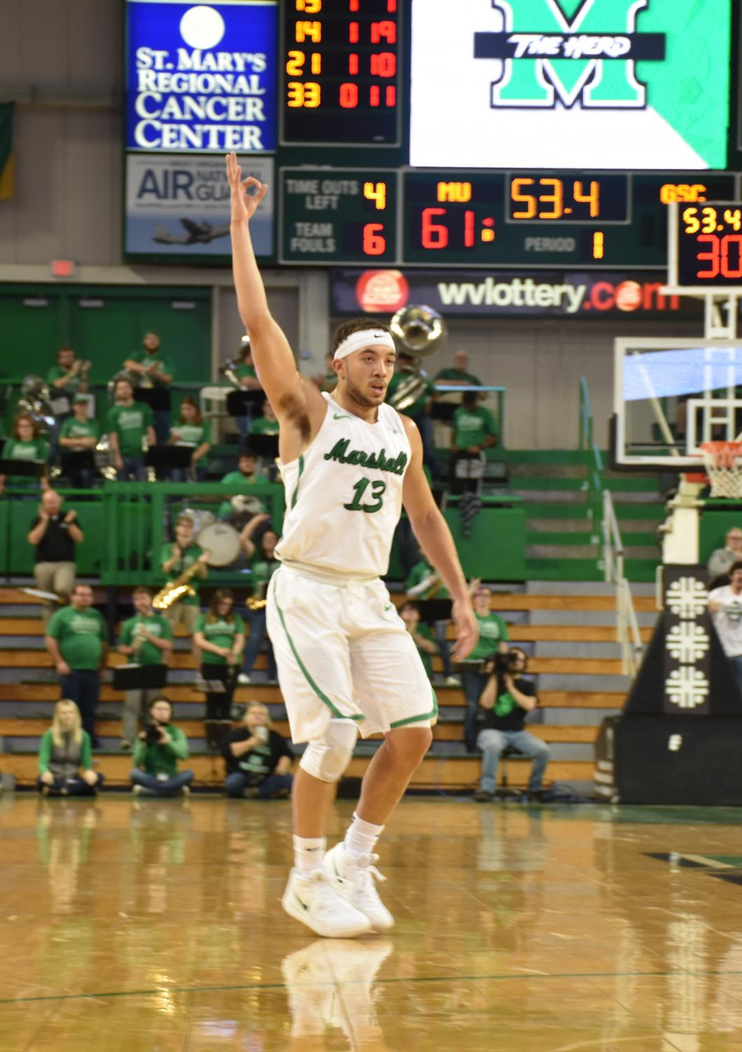 Sophomore guard Jarrod West holds up a hand gesture after hitting a 3-pointer in Marshall's 113-108 win over Glenville State. The Herd plays another exhibition Thursday before beginning the regular season Nov. 7 at Eastern Kentucky.