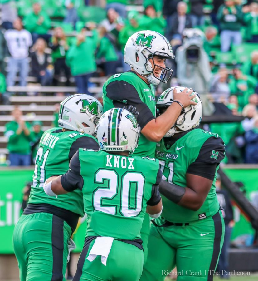 Marshall+redshirt+running+back+Brenden+Knox+%28%2320%29+joins+a+team+celebration+after+a+touchdown+in+Marshall%27s+earlier+home+game+against+Western+Kentucky.+Knox+has+a+career-high+22+rushes+for+116+and+a+touchdown+in+his+most-recent+game+against+Charlotte.+