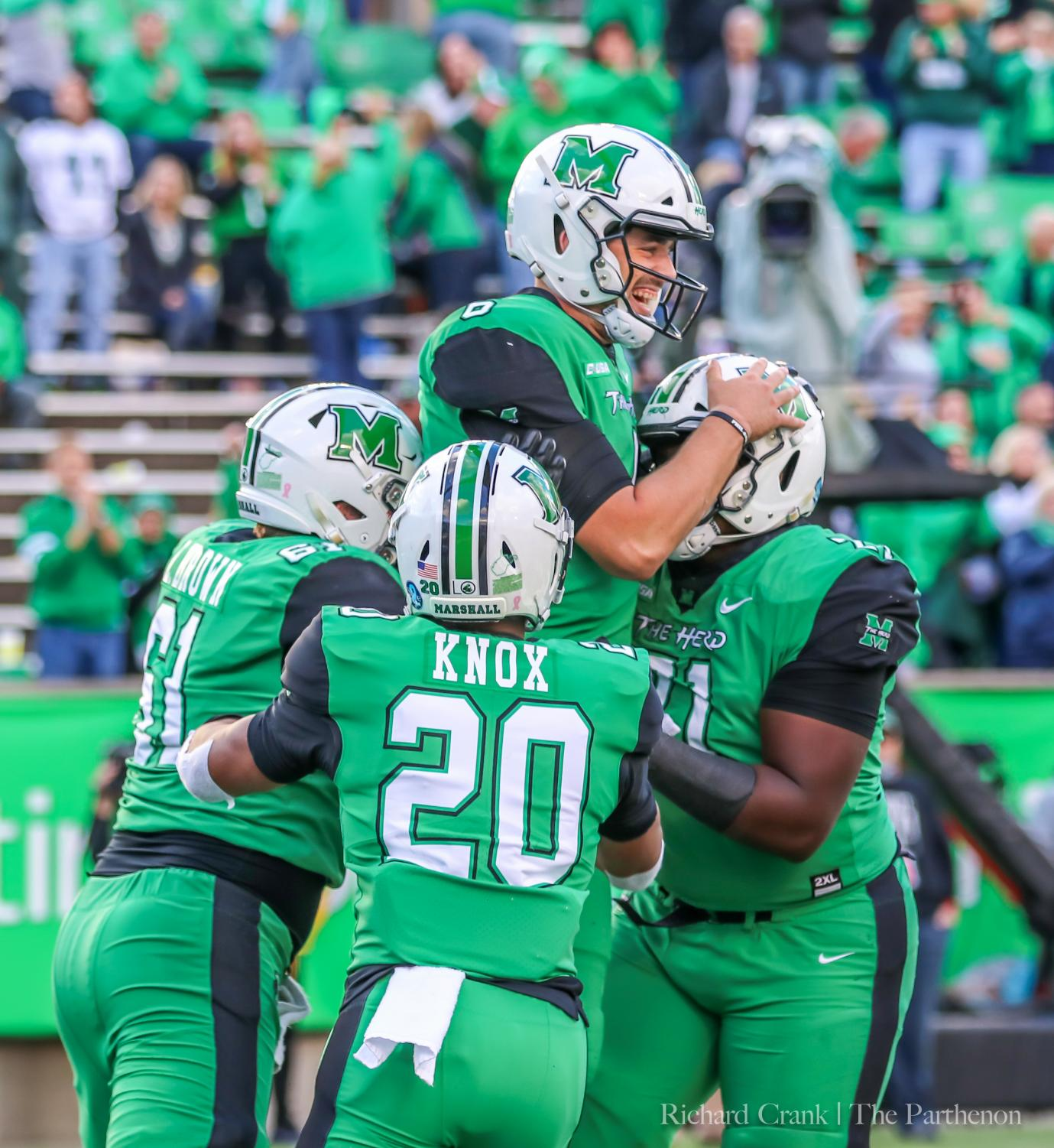 Marshall redshirt running back Brenden Knox (#20) joins a team celebration after a touchdown in Marshall's earlier home game against Western Kentucky. Knox has a career-high 22 rushes for 116 and a touchdown in his most-recent game against Charlotte.