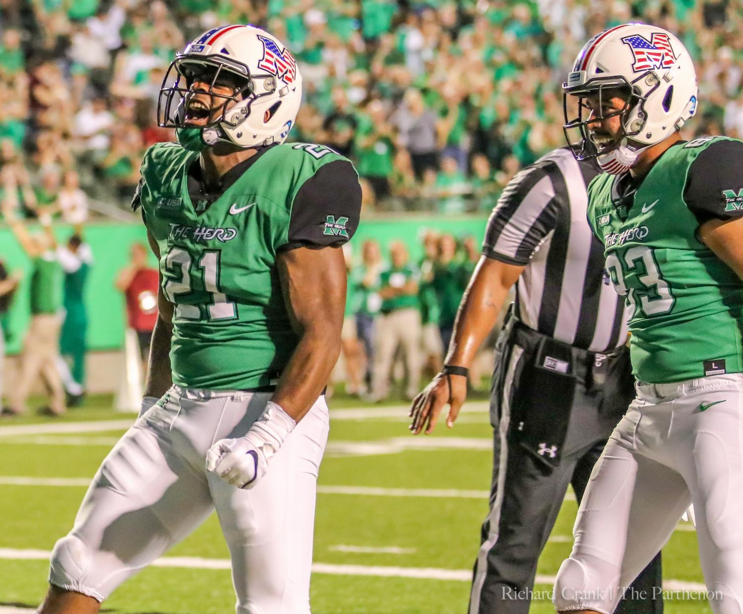 Anthony Anderson (21) celebrates his 1-yard touchdown run during the second quarter of Marshall's loss to Middle Tennessee.