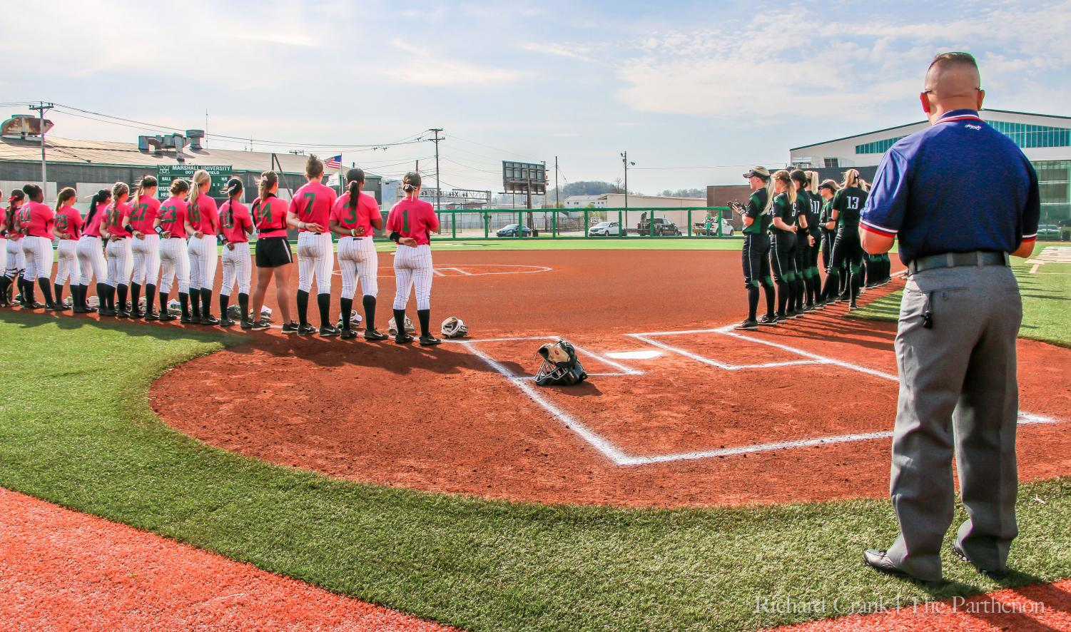 Marshall's softball team lines up for the national anthem prior to its home game against Charlotte last season.