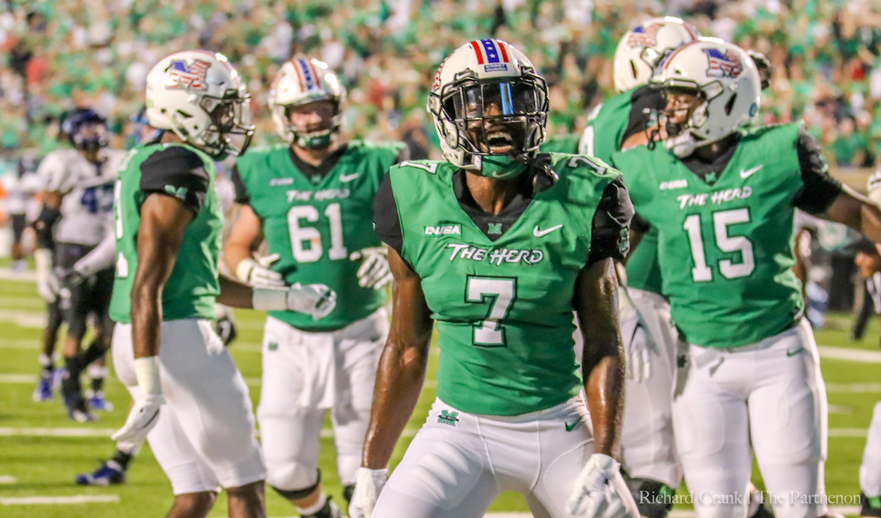 Junior wide receiver Obi Obialo celebrates a touchdown reception in Marshall's game against Middle Tennessee. Obialo is one of Marshall's most productive receivers.