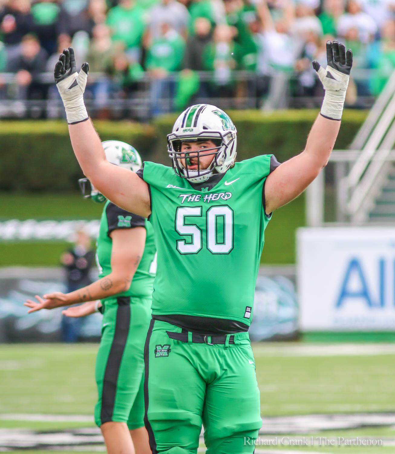 Redshirt sophomore offensive lineman Will Ulmer raises his arms in celebration after a Marshall score against FAU.