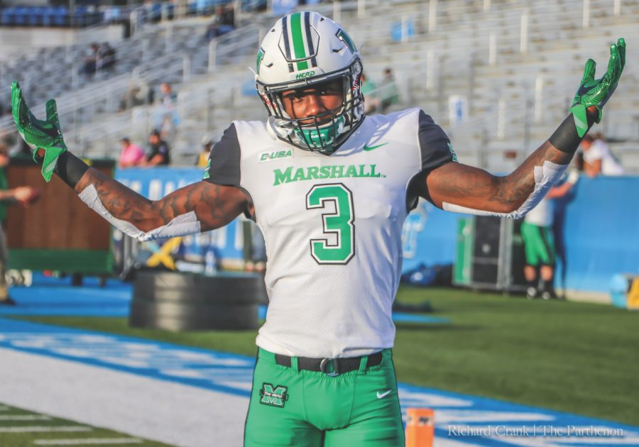 Redshirt+sophomore+running+back+Tyler+King+gestures+to+the+camera+before+Marshall%E2%80%99s+2017+matchup+at+Middle+Tennessee.+The+Herd+would+claim+victory%2C+38-10.