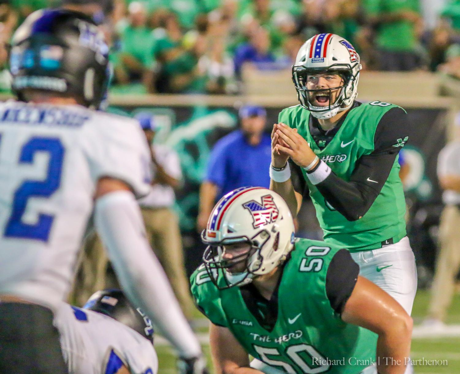 Marshall redshirt junior quarterback Alex Thomson prepares to take a snap under-center against MTSU in Saturday's home loss--his first game for the Herd.