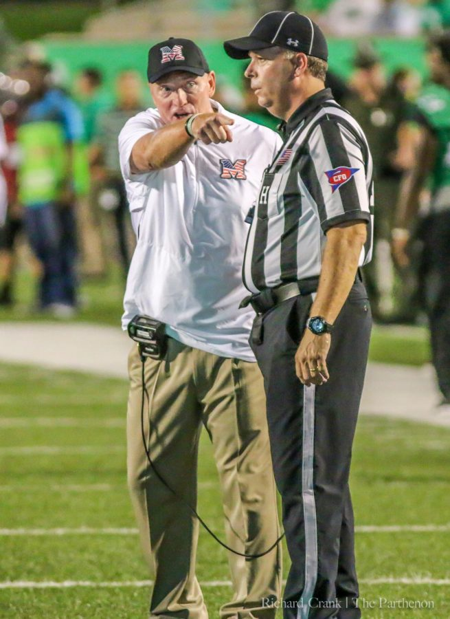 Marshall head coach Doc Holliday argues a call with one of the officials during Marshall's loss to Middle Tennessee.