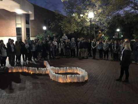 Alpha Chi Omega sponsors candlelight vigil for domestic violence