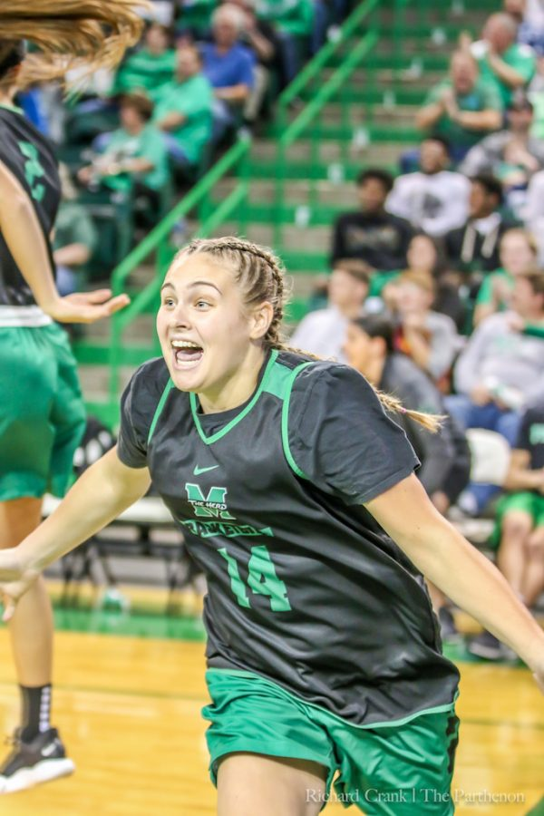 Shayna Gore celebrates after hitting multiple three-pointers in a row during Marshall's 2018-19 Herd Madness event.
