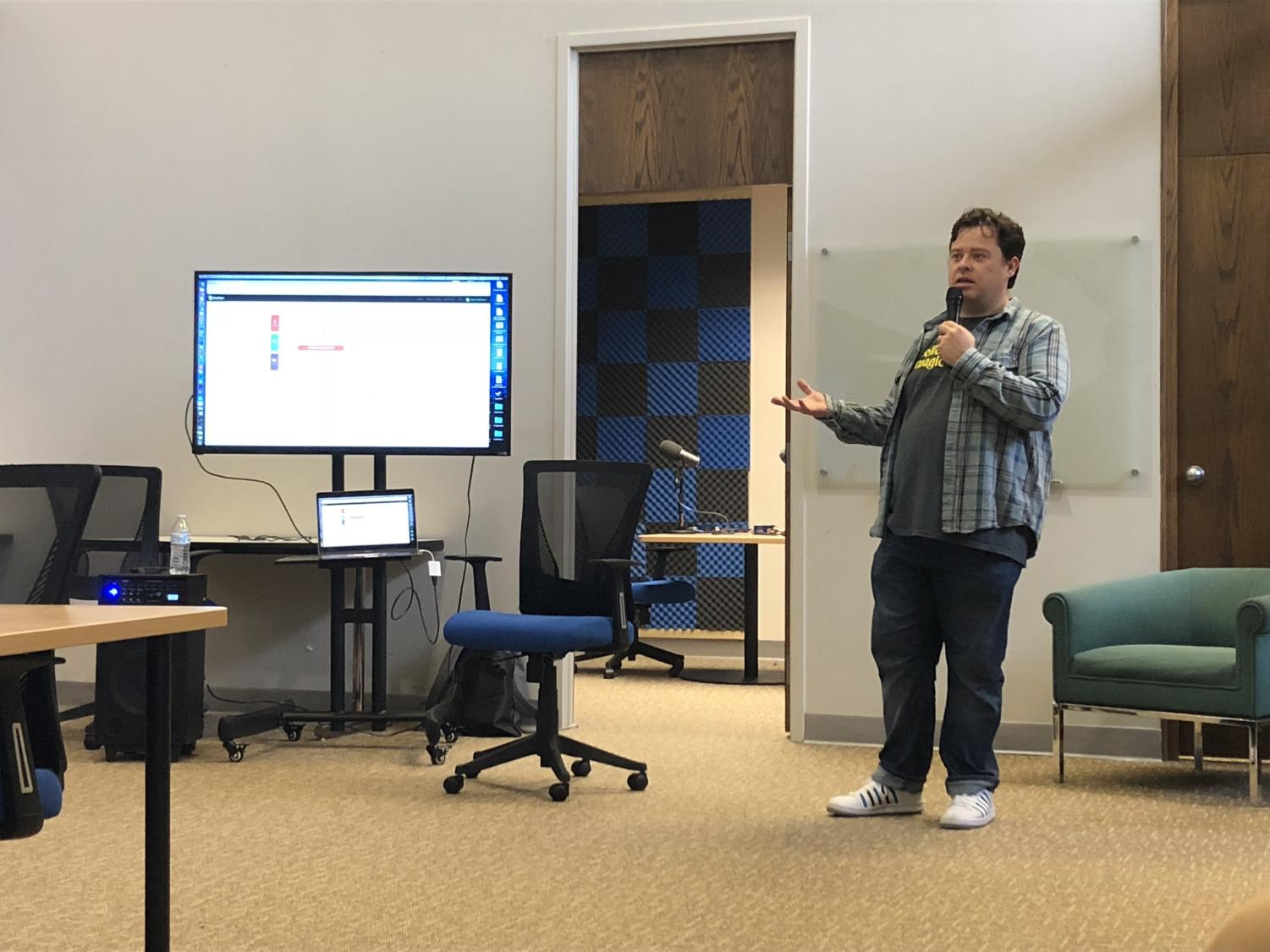 Justin McElroy, Huntington native and Marshall University graduate, teaches fellow Huntingtonians the art of podcasting in the recording studio at CoWorks.