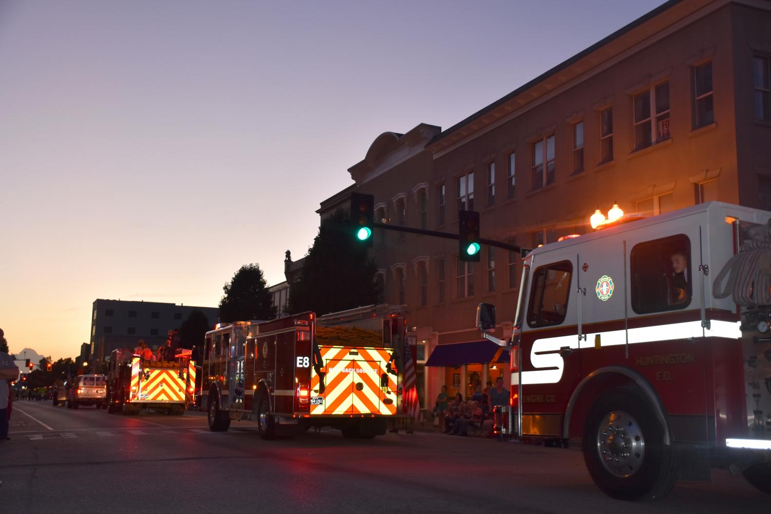 Fire trucks from local stations drive through Fourth Avenue during the 65th Annual Fire Parade.