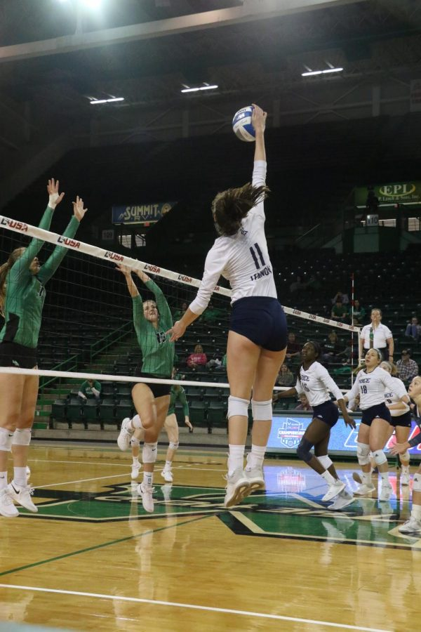 Rice+sophomore%2C+Nicole+Lennon%2C+attacks+above+the+net+for+a+kill.+She+has+a+match-high+22+kills.
