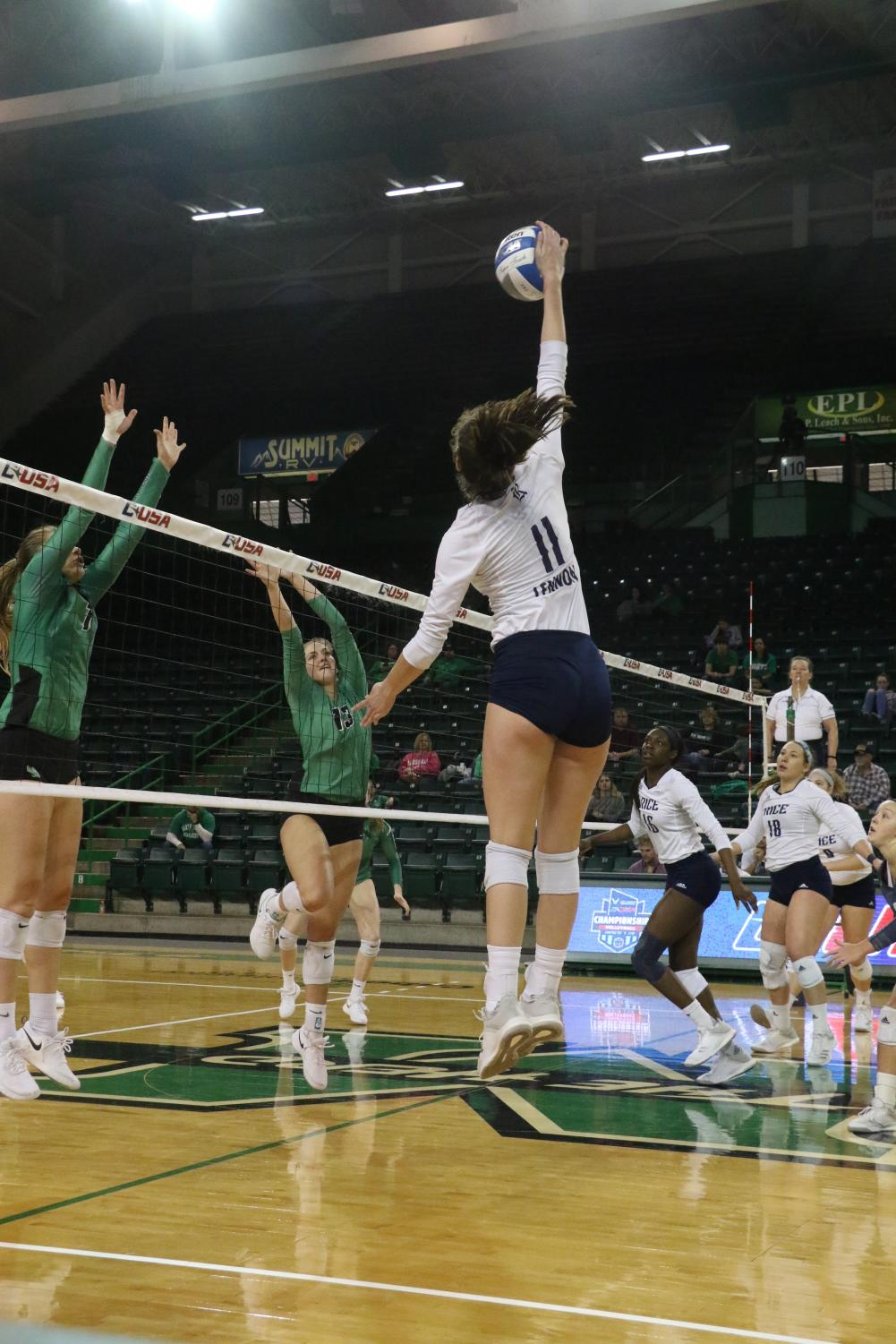 Rice sophomore, Nicole Lennon, attacks above the net for a kill. She has a match-high 22 kills.