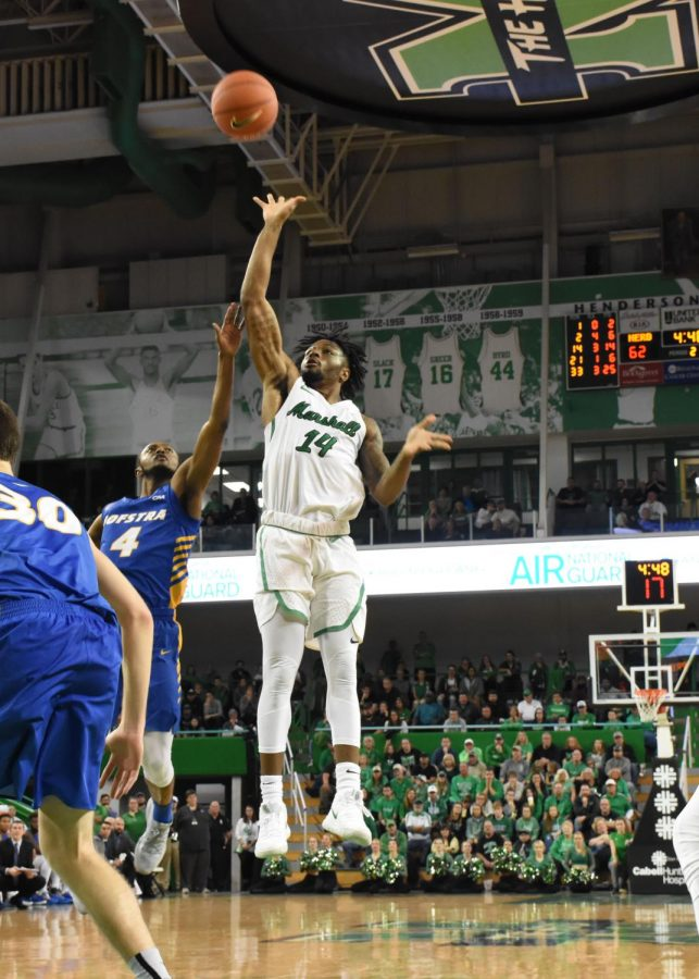 Senior+guard+C.J.+Burks+puts+up+a+floater+during+Marshall%27s+home+defeat+of+Hofstra.+Burks+scores+23+points+with+six+assists.