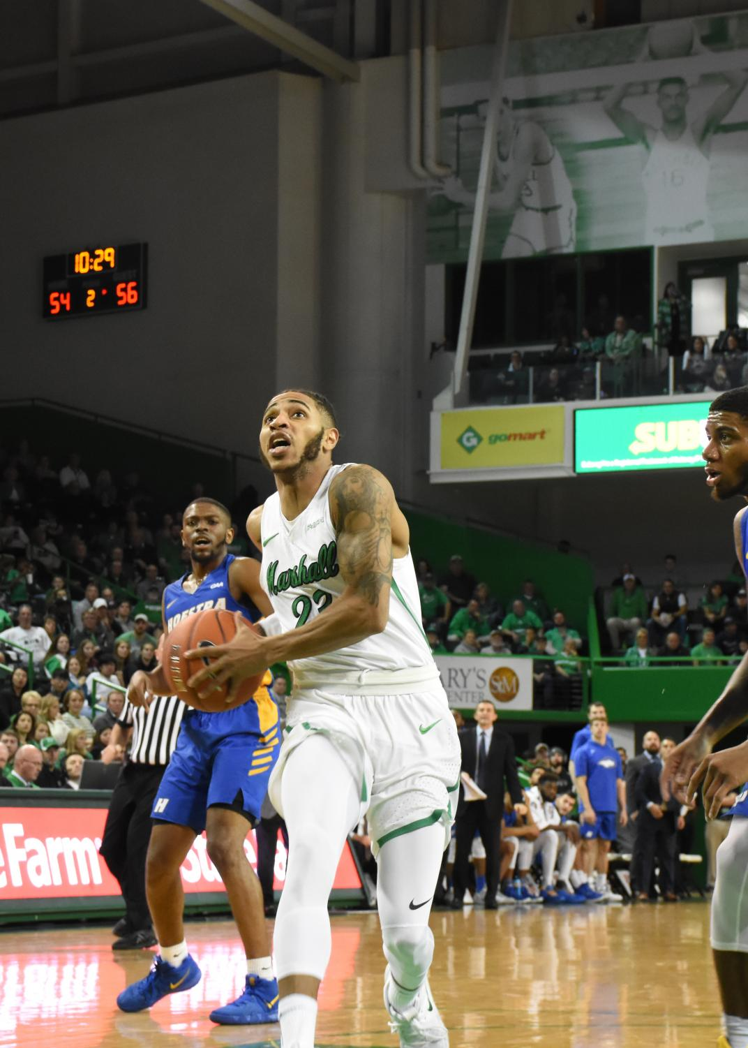 Marshall senior guard Rondale Watson drives through Hofstra defenders in the paint. Watson has 14 points in Marshall's win over the Pride.