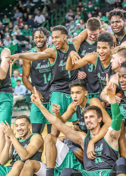 Herd men's basketball players pose for a group photo at