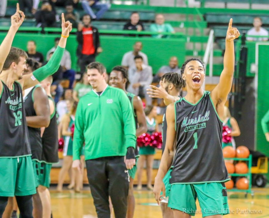 Freshman+guard%2C+Taevion+Kinsey%2C+points+in+excitement+during+%E2%80%9CHerd+Madness%E2%80%9D+at+the+Henderson+Center+prior+to+Marshall%E2%80%99s+two+preseason+games.