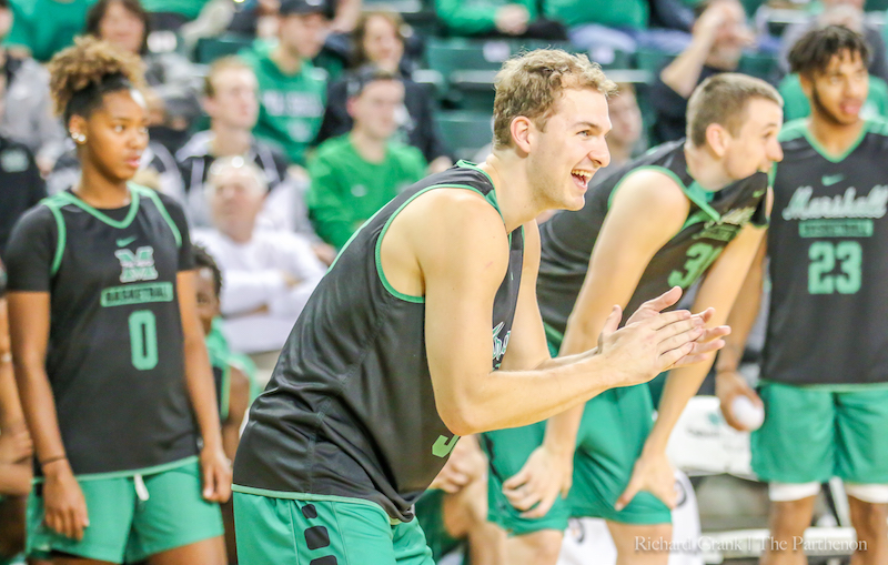 Marshall+senior+guard+Jon+Elmore+claps+during+Marshall%E2%80%99s+%E2%80%9CHerd+Madness%E2%80%9D+event+at+the+Cam+Henderson+Center+prior+to+Marshall%E2%80%99s+first+exhibition+games.+The+Herd+is+picked+to+finish+second+in+the+C-USA+preseason+poll.