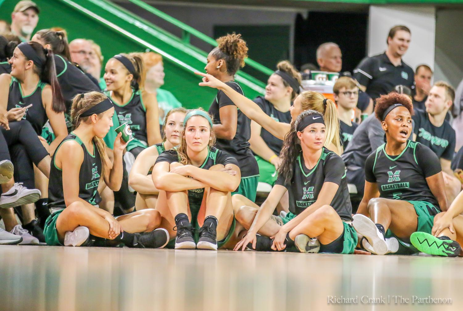"Marshall women's basketball team sits and watches the dunk contest in the Henderson Center at ""Herd Madness."""