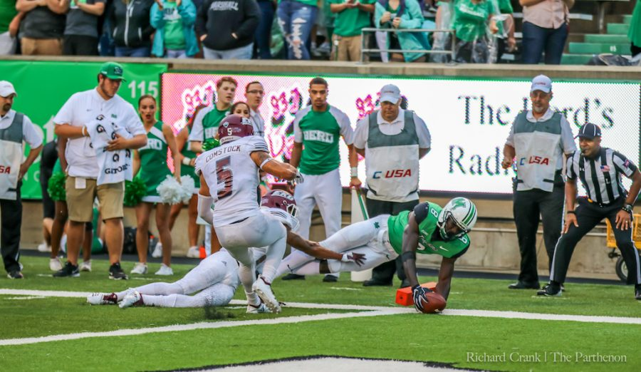 Marshall senior wide receiver Tyre Brady dives for the end zone against EKU in a recent home game. The play results in a touchdown.