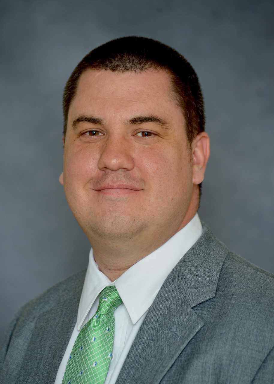 Jason Corriher is the assistant athletics director for media relations at Marshall University and oversees the sports information program.