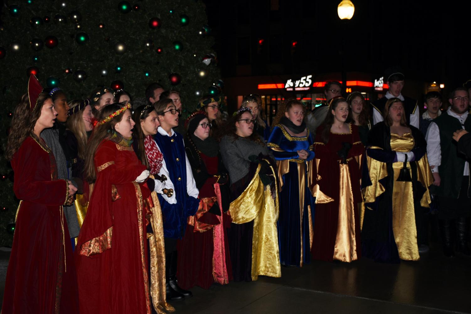 The Huntington community listens to the Cabell Midland High School Collegium Musicum during the annual tree lighting in front of the Big Sandy Superstore Arena on Nov. 27.